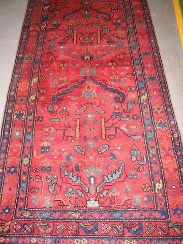 A Kurdish rug West Persia, 292cm x 103cm