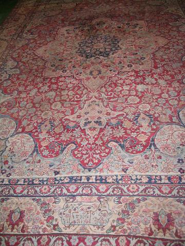 A Kirman carpet South East Persia, 402cm x 279cm