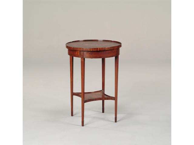 An Edwardian satinwood occasional table