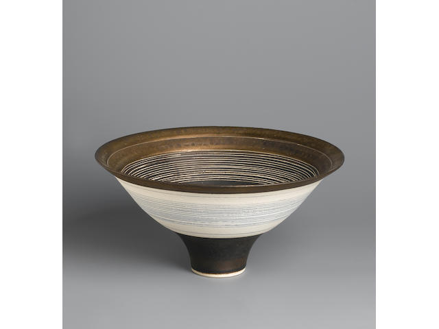 Dame Lucie Rie a footed Bowl with inlaid and incised circles, circa 1970 Diameter 9in. (23cm)