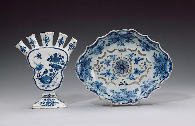A Dutch Delft quintal vase and a strawberry dish circa 1720 and 1770
