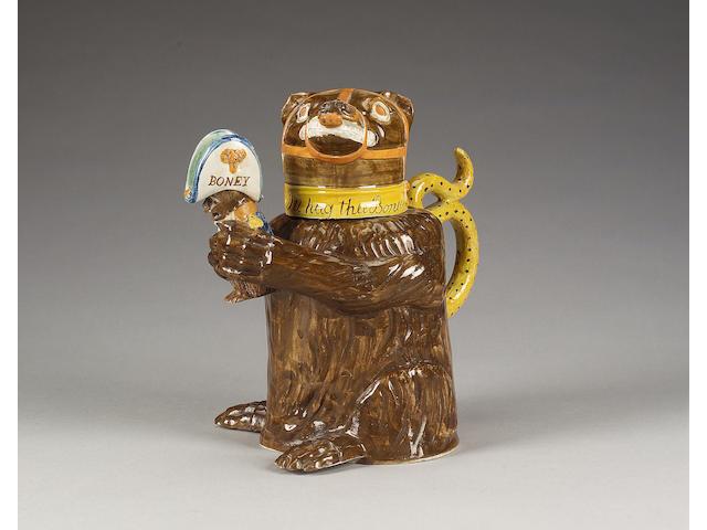 A Pratt Ware Napoleonic 'Bear Baiting' jug and cover, circa 1800,