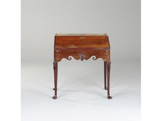 A mid 18th century style mahogany bureau