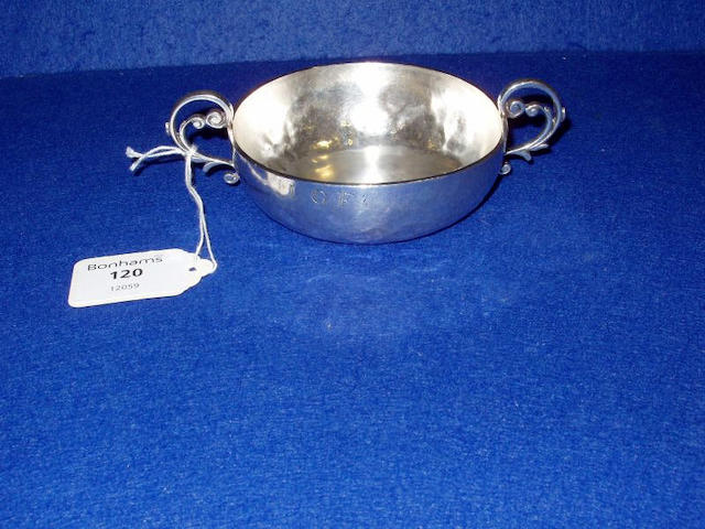 An early 18th century Channel Islands silver Jersey pattern christening bowl, stamped once on side with maker's mark GS below a crowned fleur de lys, Jersey circa 1710,