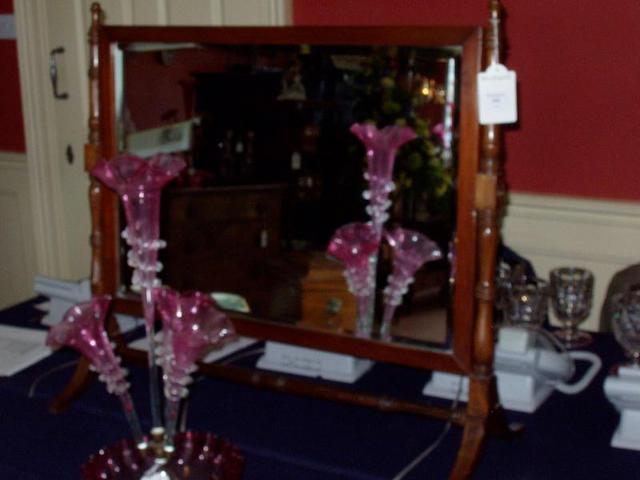 A mahogany rectangular toilet mirror,