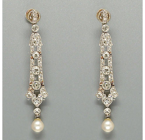 A pair of early 20th century diamond and pearl earpendants,