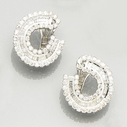 A pair of diamond-set earclips