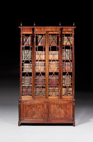 A late George III mahogany upright bookcase of narrow form