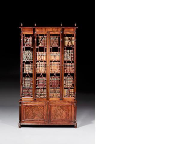 A late George III mahogany upright bookcase of narrow form