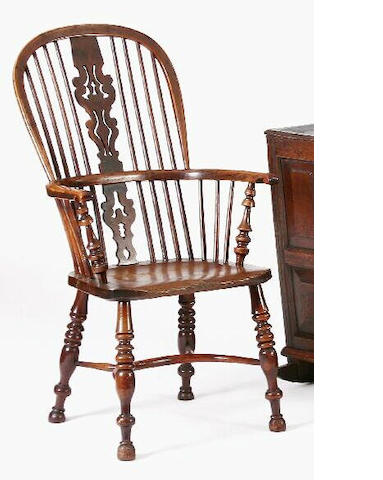 A mid 19th Century yew high back Windsor chair,