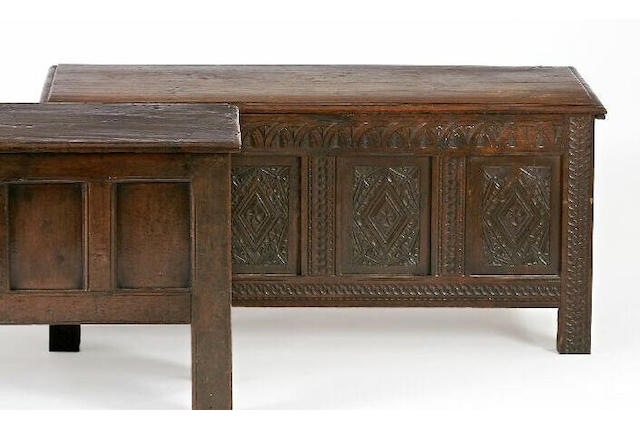 A 17th Century oak and later carved coffer,