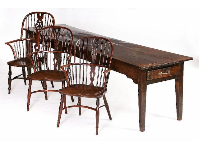 A large early 19th Century oak farmhouse table,