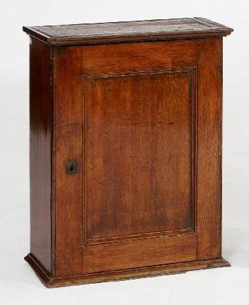 A late 18th Century oak spice cupboard of rectangular form,