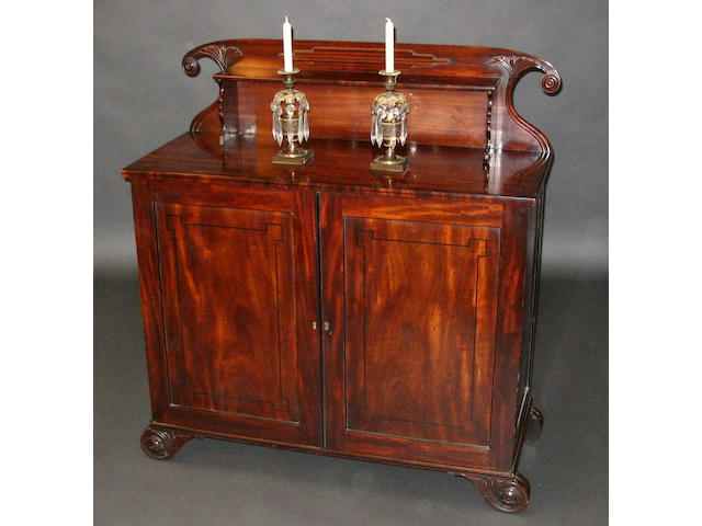 A George IV figured mahogany and ebony line inlaid chiffonier