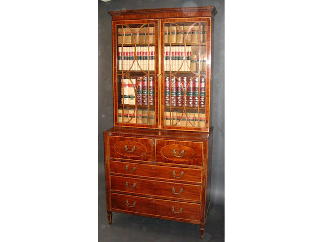 A George III Sheraton design mahogany, satinwood crossbanded and line inlaid secretaire bookcase