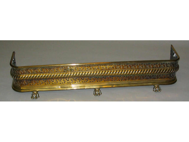 A 19th Century Dutch style polished and pierced brass fender,