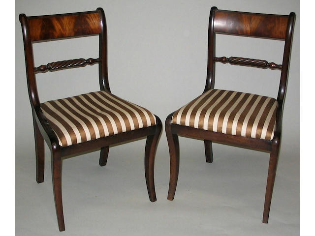 A set of four George IV figured mahogany standard chairs of good colour,