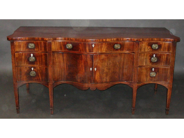 A late 18th Century figured mahogany and boxwood line inlaid serpentine fronted sideboard of good colour