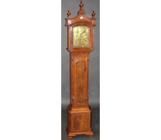 A small figured mahogany longcase clock