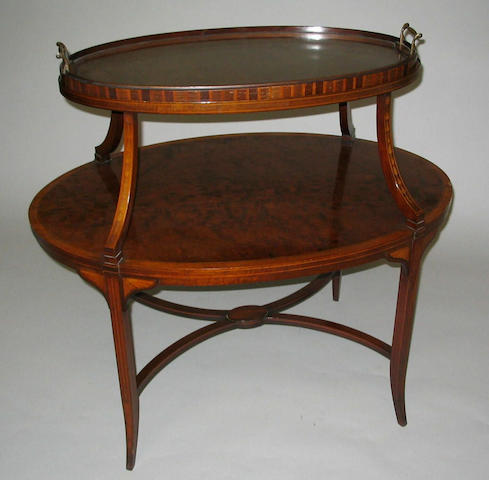 An Edwardian Sheraton revival 'plum pudding' mahogany and line inlaid etagere