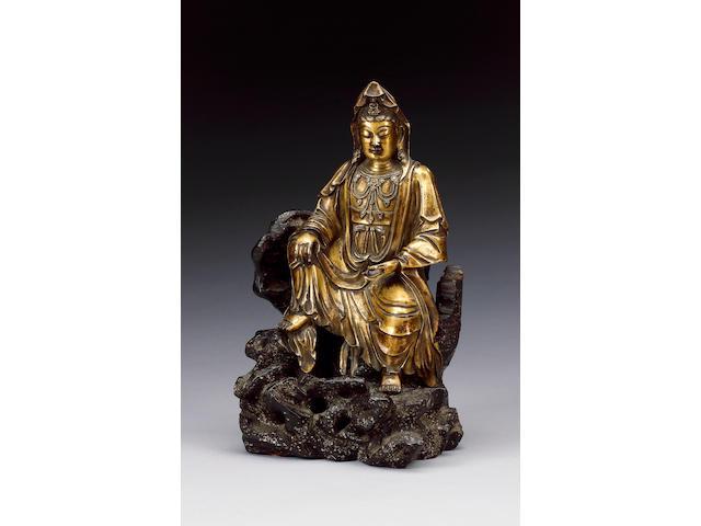 An elegant gilt bronze figure of Guanyin,