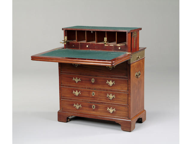 A mahogany and brass mounted harlequin games, writing and dressing chest