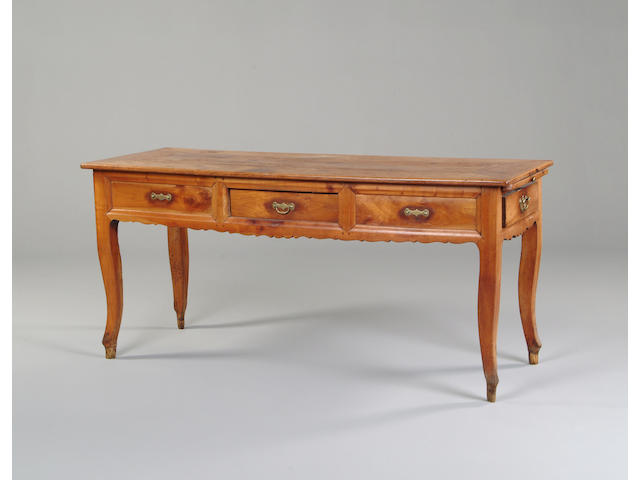 A late 19th century French chestnutwood table