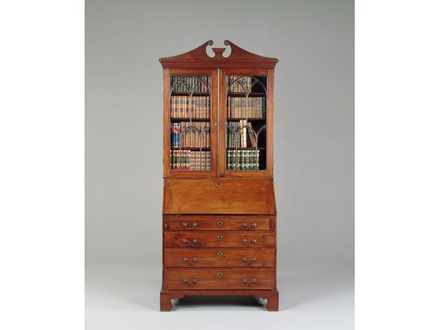 A mahogany bureau bookcase