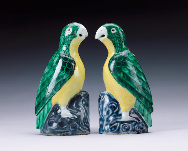 A pair of green and yellow parrots,