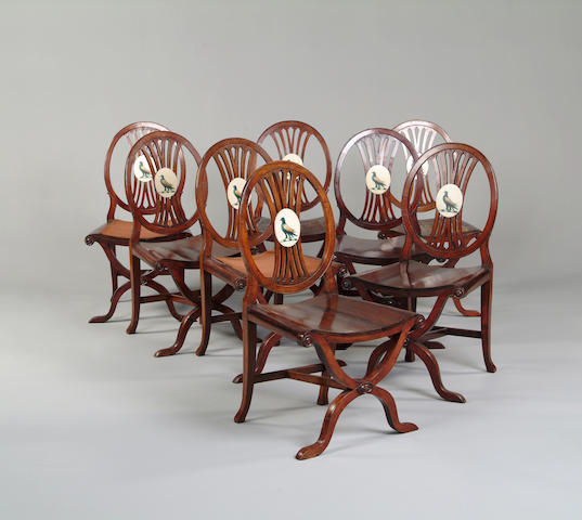 A set of eight George III style mahogany hall chairs