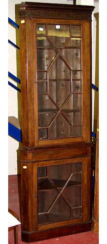 A floor standing mahogany corner cabinet