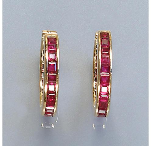 A pair of ruby set hoop earrings,