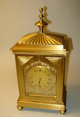 A Regency style gilt brass mantel timepiece