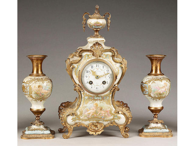 A gilt metal mounted Continental porcelain clock garniture, circa 1890,