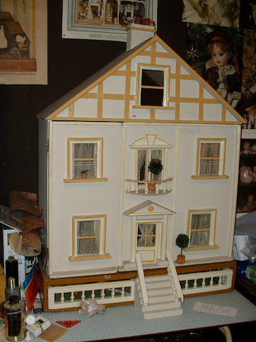 Painted wooden Doll's house with garden, English circa 1910