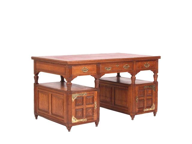 An Arts and Crafts oak desk