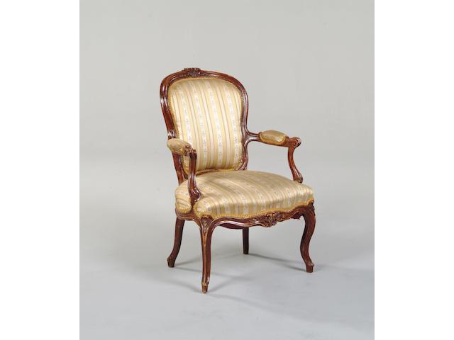A 19th Century beechwood open armchair,