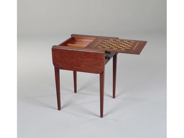 A George III mahogany crossbanded Pembroke games table
