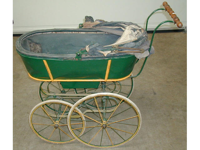 A scarce papier-mache panelled pram, 1893, made in London.