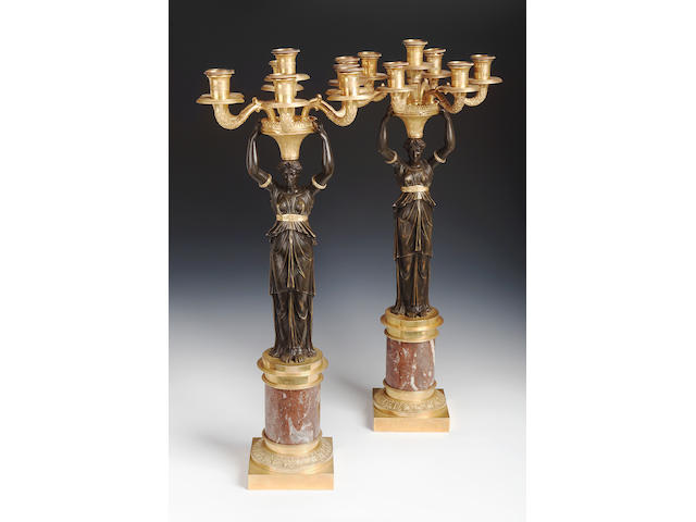 A pair of Regency canelabra with seven sconces