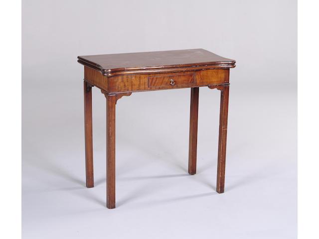 A Waring and Gillow mahogany tea table,