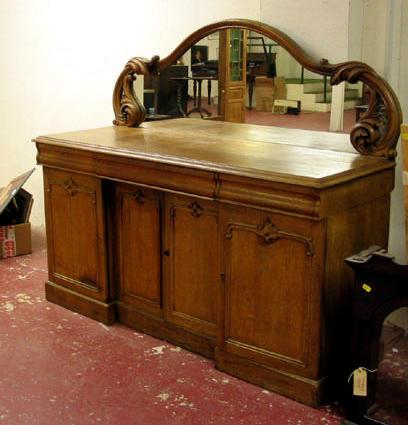 An oak mirror backed chiffonier sideboard