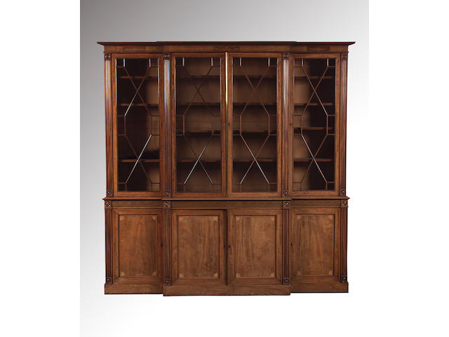 A George III style mahogany and satinwood crossbanded breakfront library Bookcase,