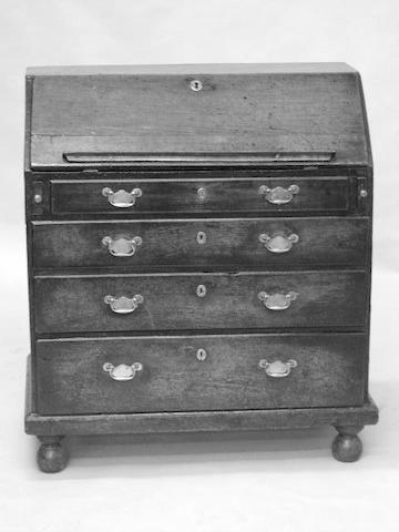 An early 18th Century provincial oak bureau,