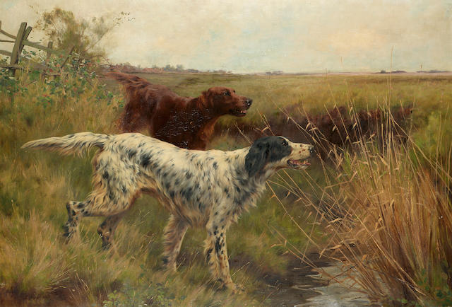 Thomas Blinks (British 1860-1912) An English setter and an Irish setter in a landscape 69 x 99.5 cm. (27 x 39 in.)