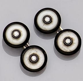 A diamond, onyx and frosted rock crystal dress set Comprising a pair of double cufflinks, and four b