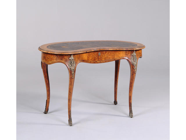 A Victorian walnut and gilt metal mounted kidney shaped table