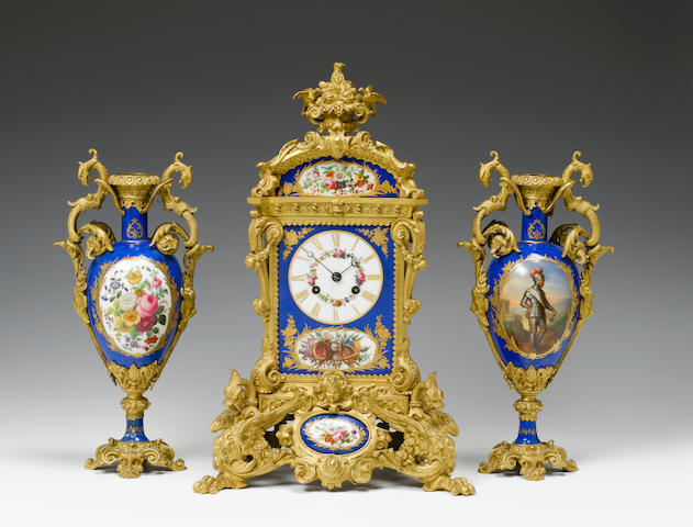 A good 19th century French porcelain mounted ormolu clock garniture Retailed by Charles Frodsham, movement by Pons