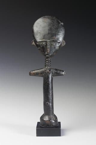 An Ashanti wood Akuaba doll 30.5cm., mounted