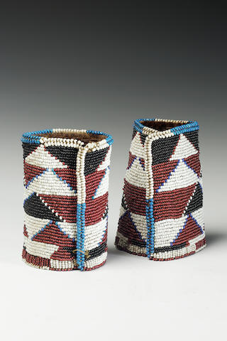 A pair of Zulu beaded cuffs each 13cm. high